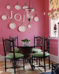 green chairs pop in a pink dining room