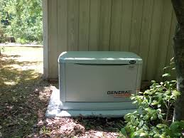 generac 20 kilowatt whole house generator installed on a preformed concrete pad by northern neck t21 generator