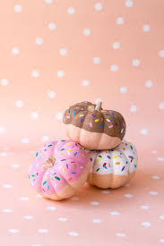 small pumpkins are cute themselves but when painted as donuts they become even more adorable dip the little cuties in paint and create sprinkles with a
