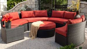 round outdoor conversation set with red sunbrella cushions