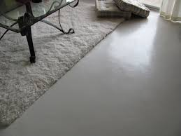 inside house painting concrete floor with white color look like tile in the bedroom with white fur rug ideas