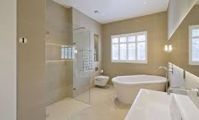 contemporary bathroom with corner freestanding tub
