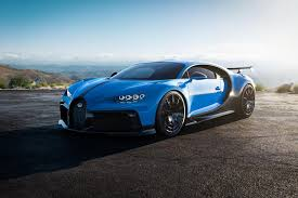 The words chiron sport are written on the center console inlay in red. Bugatti Chiron Pur Sport Review Trims Specs Price New Interior Features Exterior Design And Specifications Carbuzz