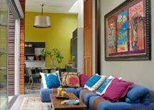 A colorful sofa or couch can give that old living room a new lease on life  and transform a mundane setting into an interesting and breezy space.