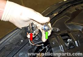 bmw e60 5 series xenon headlight replacement 2003 2010 pelican high beam bulb pull the headlight bulb green arrow out of its socket