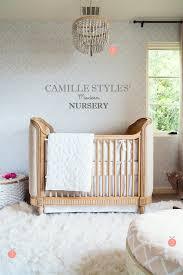 camille styles nursery decor from serena and lily 1 malibu chandelier 2 presidio glider 3 flokati rug 4 ottomans white chakki 5