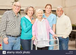Geriatric Nursing Group Of Seniors As Friends Together With Geriatric Nurse In