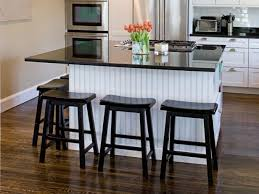 Kitchen islands with breakfast bar Rustic Kitchen Black And White Kitchen Island Hgtvcom Kitchen Islands With Breakfast Bars Hgtv