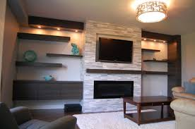 beautiful stacked stone tile fireplace surround with fireplace mantel shelf and fireplace screen