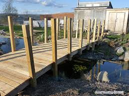 how to build an arched foot bridge build a garden bridge from wooden boards