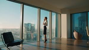 modern office. Young Business Woman In Modern Office Skyscraper The Talks On Phone Standing At