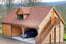 wooden house with double y garage with gl doors
