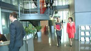 group contemporary office. Business Group And Receptionist In A Large Contemporary Office Building. High Quality HD Video Footage D