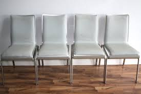 set of  leather dove gray and silver dining chairs