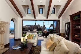 fascinating craftsman living room chairs furniture: ocean view craftsman living room with exposed beams high ceiling windows and dark wood floors