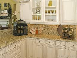 image of off white kitchen cabinets with granite countertops