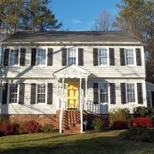 white house navy shutters yellow front door what color shutters would look best with white vinyl siding house and parkway blvd doors
