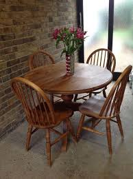 solid pine round table and 4 chairs stained and waxed