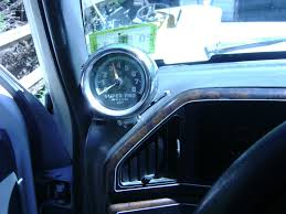 best place to hook a tach into f150online forums in this one u can see ware i mounted my tach its out of the way but still easly seen plus it was easy to hide the wires going down into the