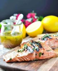 olive garden lighter italian fare herb grilled salmon garlic and herb salmon marinade on a wooden board olive garden lighter italian fare herb grilled