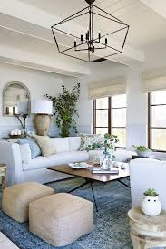 Image Exposed Beams Plushemisphere Chic Coastal Living Room With Touches Of Blue And Light Blue