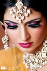 her eye makeup lips are so astonishing makeup bride brides bridal eyemakeup wedding marriage weddingindia india indian lipstick eyelid tikka