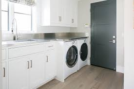 White Laundry Room With Stainless Steel Countertop And