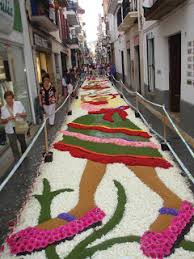 corpus christi flower festival for one day each year all the major streets of sitges are decorated with colorful intricate designs of flower petals