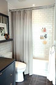 wood shower curtain or glass door on tub