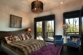 beautiful drum chandelier in bedroom rustic with drum chandelier next to tommy bahama style furniture alongside modern mountain home and throw pillows