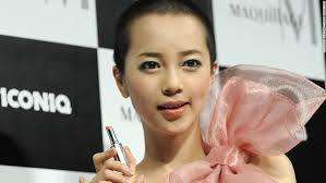 here pop singer iconiq displays a shiseido lipstick on january 19 2010 after