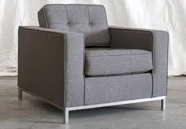 Modern cubic club chair, upholstered in grey, over a brushed metal frame