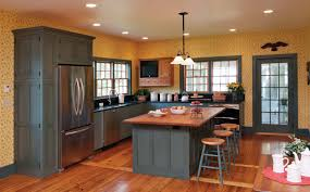 pretty painted kitchen cabinet and brown modern countertop