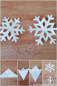 diy decoration with paper snowflakes and pine cones
