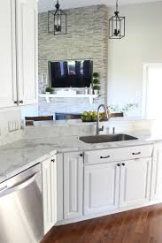 see how it all began with painting our kitchen cabinets white here