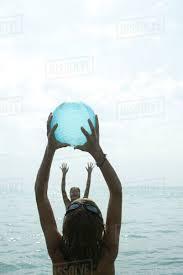Beach ball in ocean Clipart Teen Girls Playing With Beach Ball In Sea Dissolve Teen Girls Playing With Beach Ball In Sea Stock Photo Dissolve