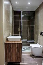 A luxury small bathroom with walkin shower enclosure on display at the Room  H2o bathroom and