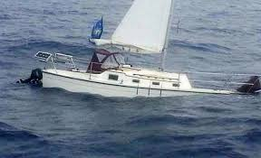 Image result for sinking sailboat