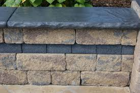 2 inch aggressive stone liner used to form a wall cap
