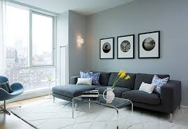 living room decoration ideas with blue gray paint color and black sofa