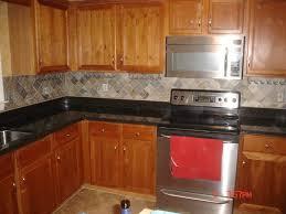 black granite countertops with tile backsplash. Mesmerizing Kitchen Tile Backsplash Ideas With Oak Cabinets Alongside Single Wall Electric Oven And Wine Glass Black Granite Countertops T