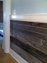 little house on the prairie meets modern decor with this wood plank chair rail using diffe hued pieces of wood will give more depth and dimension to