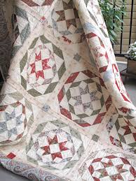 Have you seen Rosettes? Our classic and vintage Christmas quilt ... & Our classic and vintage Christmas quilt was made using fabrics from Adamdwight.com