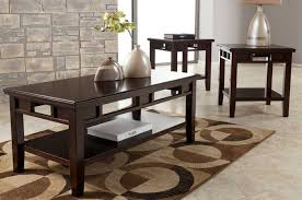 logan description coffee table and end table set ashley furniture features statusque elegance books decorative items