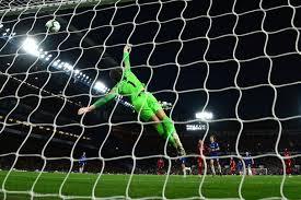 liverpool s english striker daniel sturridge scores the team s first goal past chelsea s spanish goalkeeper kepa arrizabalaga