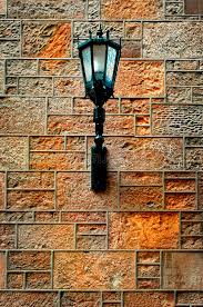 light fixture on stone wall stock image image 11277421