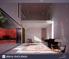 Living Room Uk Double Height Living Room With Mezzanine And Open Concertina Glass