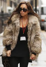 myleeen klass wore a huge furry coat as she stepped out in london