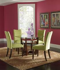 romantic green dining room using 4 uphostery green fabric cover armless dining chairs set with red wall painted interior