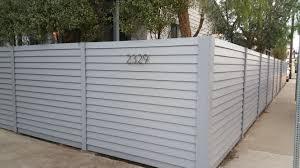 custom horizontal wood fence complimentary utility enclosure pedestrian gates venice los angeles